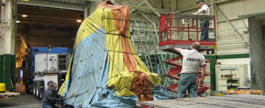 workers are loading and tarping the shipment